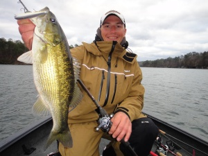 Gussy with a nice spotted bass caught on a Jackall Squad Minnow 115 jerkbait in practice.